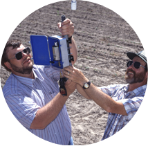 Agricultural engineers Bradley King (left, of the University of Idaho, and Dennis Kincaid, with the ARS Northwest Irrigation and Soils Research Laboratory at Kimberly, attach a variable-flow sprinkler head to an irrigation system